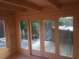 """Gartenhaus """"Lucas E"""" mit Veranda und 3x3 m Anbauschuppen"""