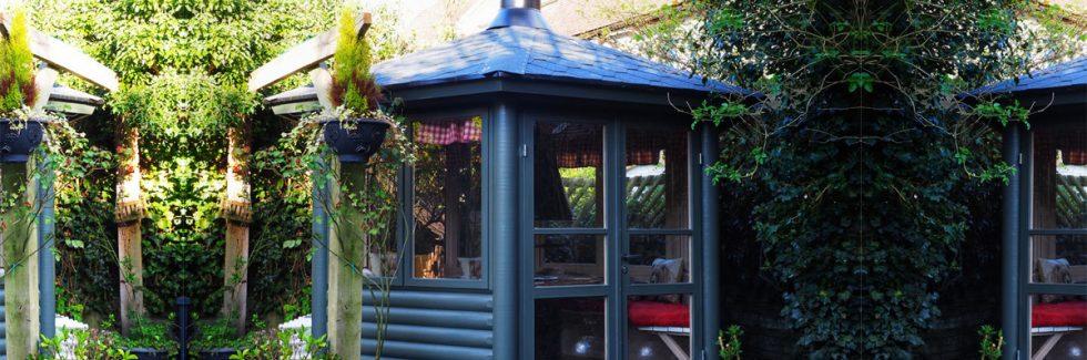 Einen Holzpavillon in die Gartenarchitektur einbinden