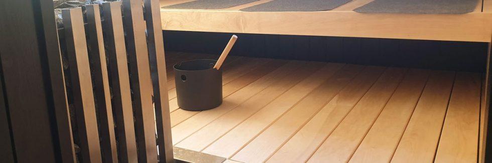 Wie bauen Sie eine Sauna in ein Blockhaus ein?